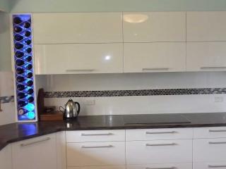 Kitchen wine racks backlit in single stack