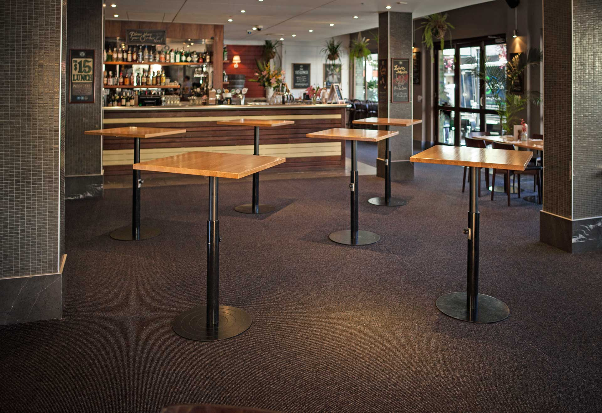 Height Adjustable tables set at bar height