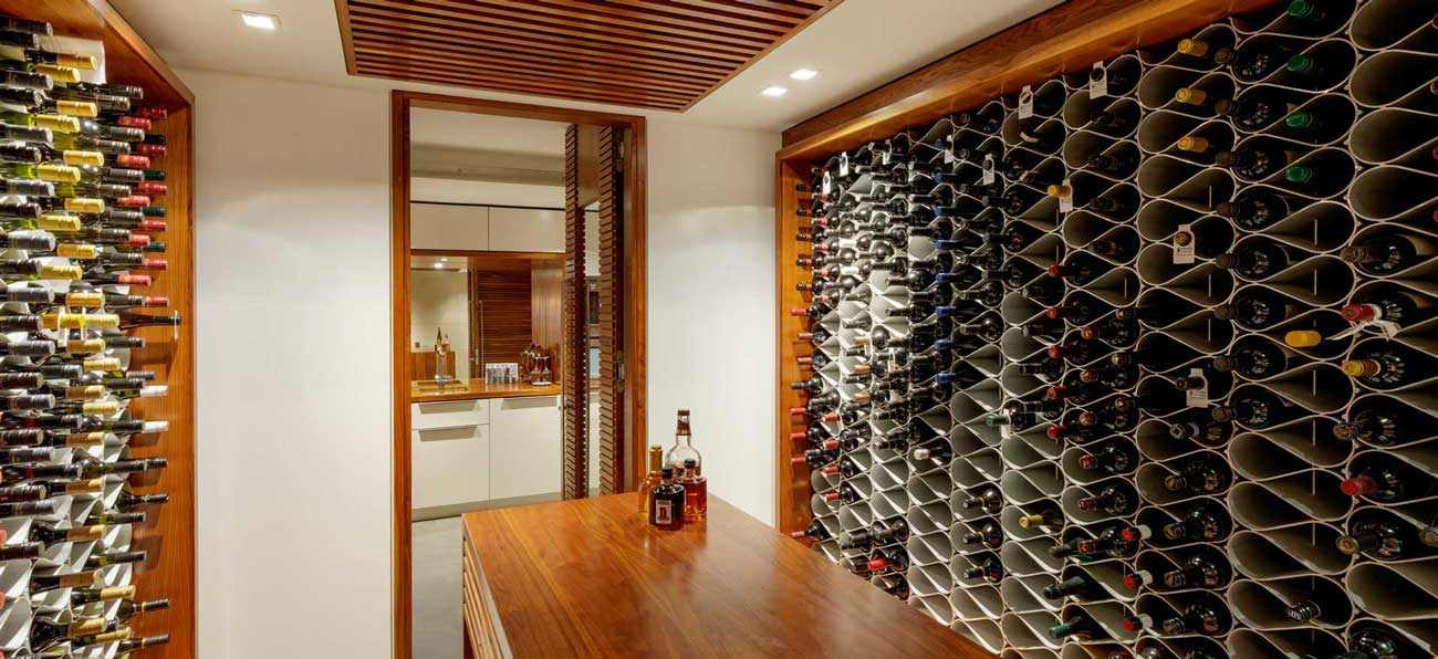Echelon wine cellar racking in built-in joinery